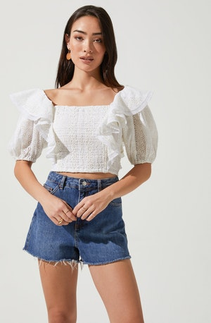 Square Neck Blouse - This piece perfectly fuses sophisticated aesthetics with contemporary details. It emphasizes an elegant square neck. Style it with a skater skirt for a casual look.