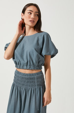 Blue Solid Shorts Sleeve Blouse - This blouse effortlessly takes you from day to night, without compromising on style. It features a neat crew neck. Style it with a skater skirt for a casual look.