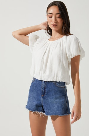 White Solid Shorts Sleeve Blouse - This blouse effortlessly takes you from day to night, without compromising on style. It flaunts a round neckline. Team it up with a tight skirt for a daytime date look.
