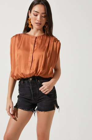 Solid Blouse - This is an outfit that easily goes from morning coffee to post-work happy hour. It showcases a crew neck that complements the silhouette. Pairing a palazzo with this one will give a cool and comfy look.
