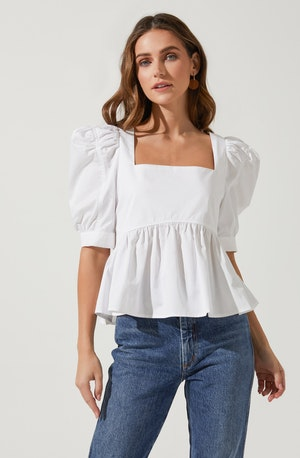 Shorts Sleeve Solid Blouse - This is a versatile piece that looks good all day long. It flaunts a modish square neck. Wear it with a pencil skirt or a pair of skinny jeans.
