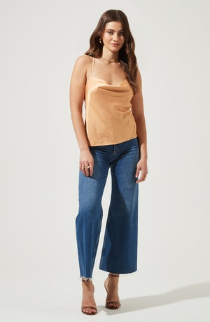 Solid Camisole - Heighten your style quotient with this piece for a chic and sassy appeal. It features a cowl neck that both contrasts and complements its shape.